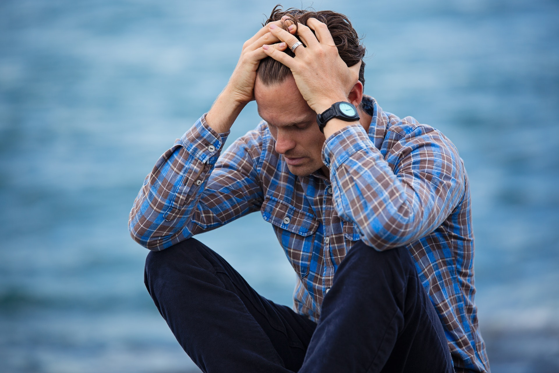 Man in Blue Environment Looking Distressed